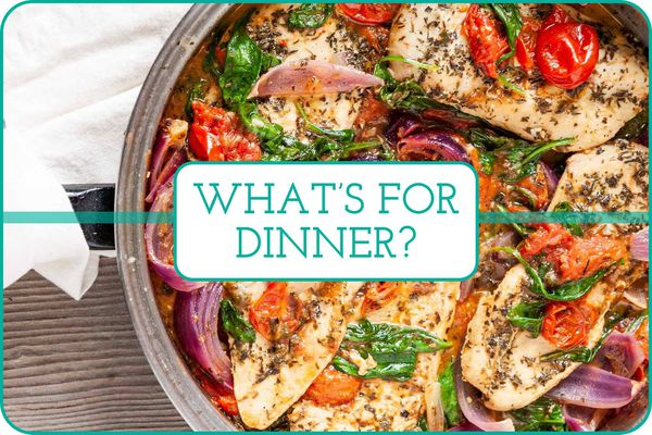 Skillet of chicken breast, tomatoes, spinach, and red onion with a white towel around the handle and a text over the image that says what's for dinner?