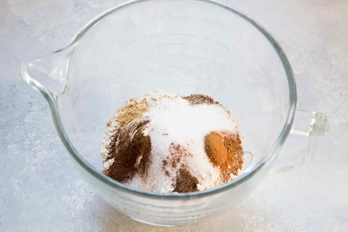 The dry ingredients for hot cross buns: flour, salt, spices, and sugar