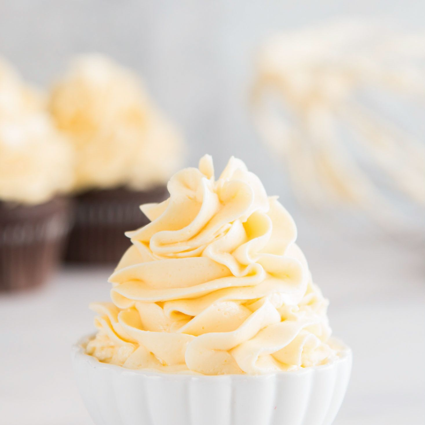 French meringue buttercream piled high in a small bowl.