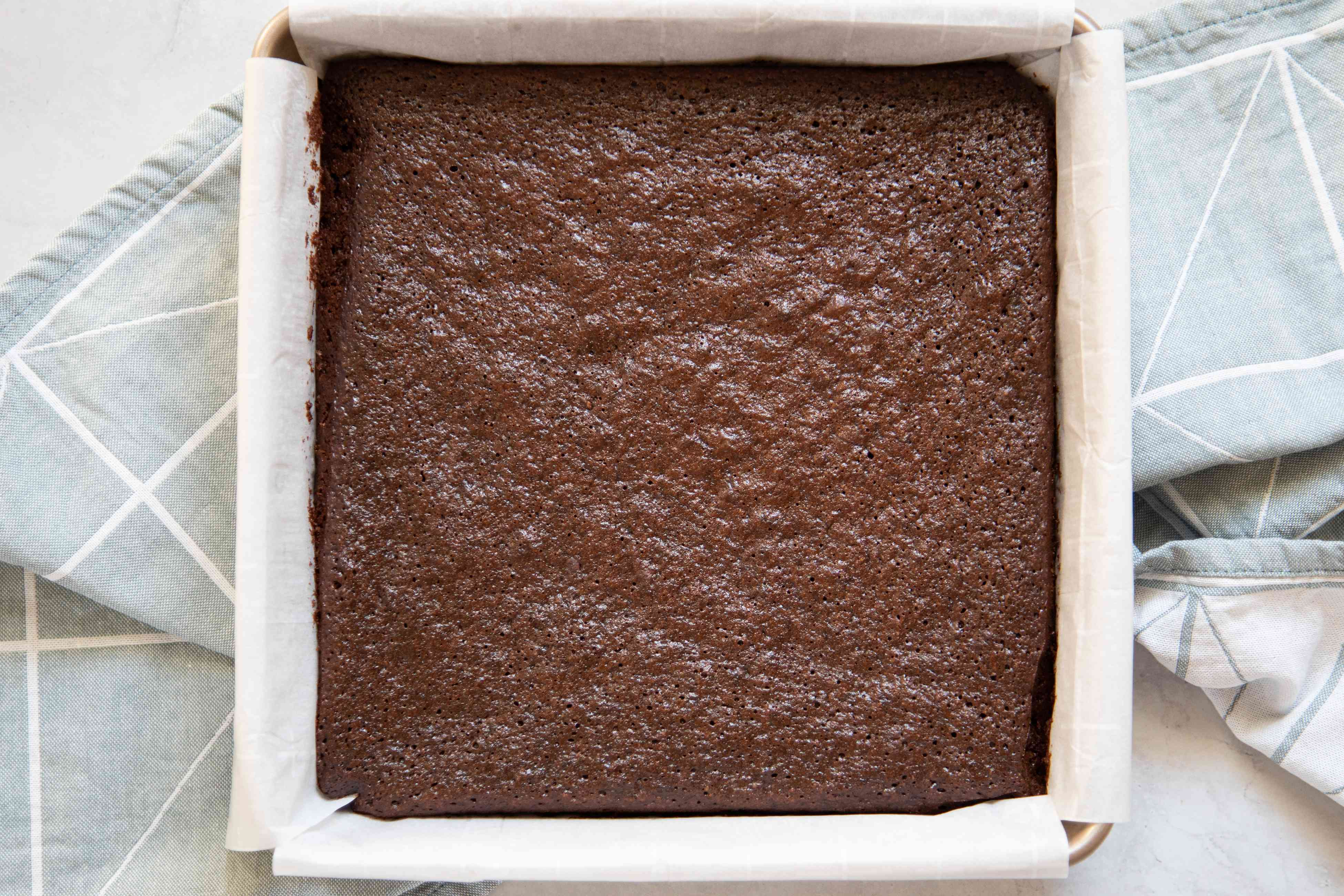 Baked Gluten-Free Soy Sauce brownies cooling in the pan.