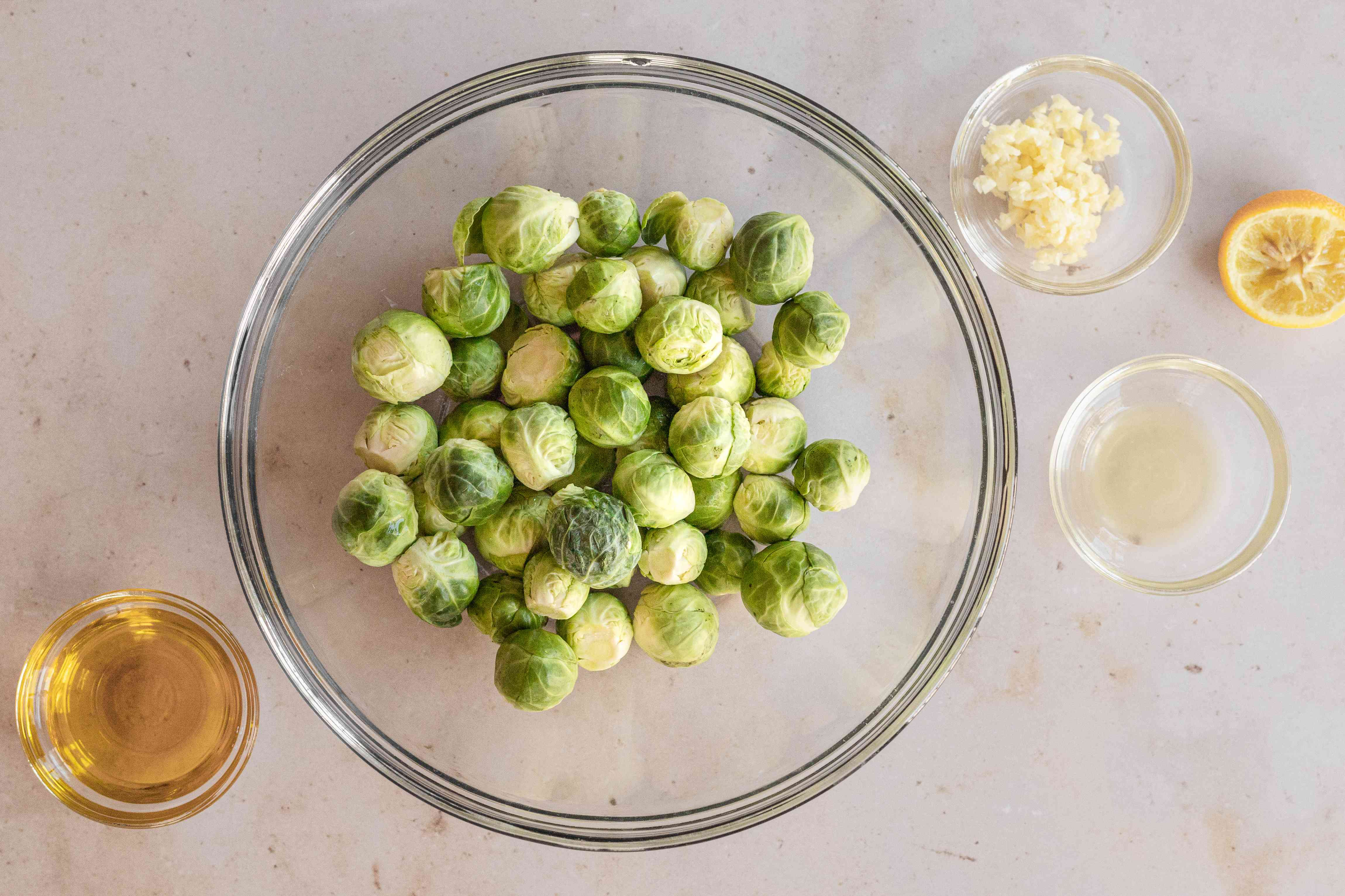 Making the best brussel sprouts recipe in a glass dish.