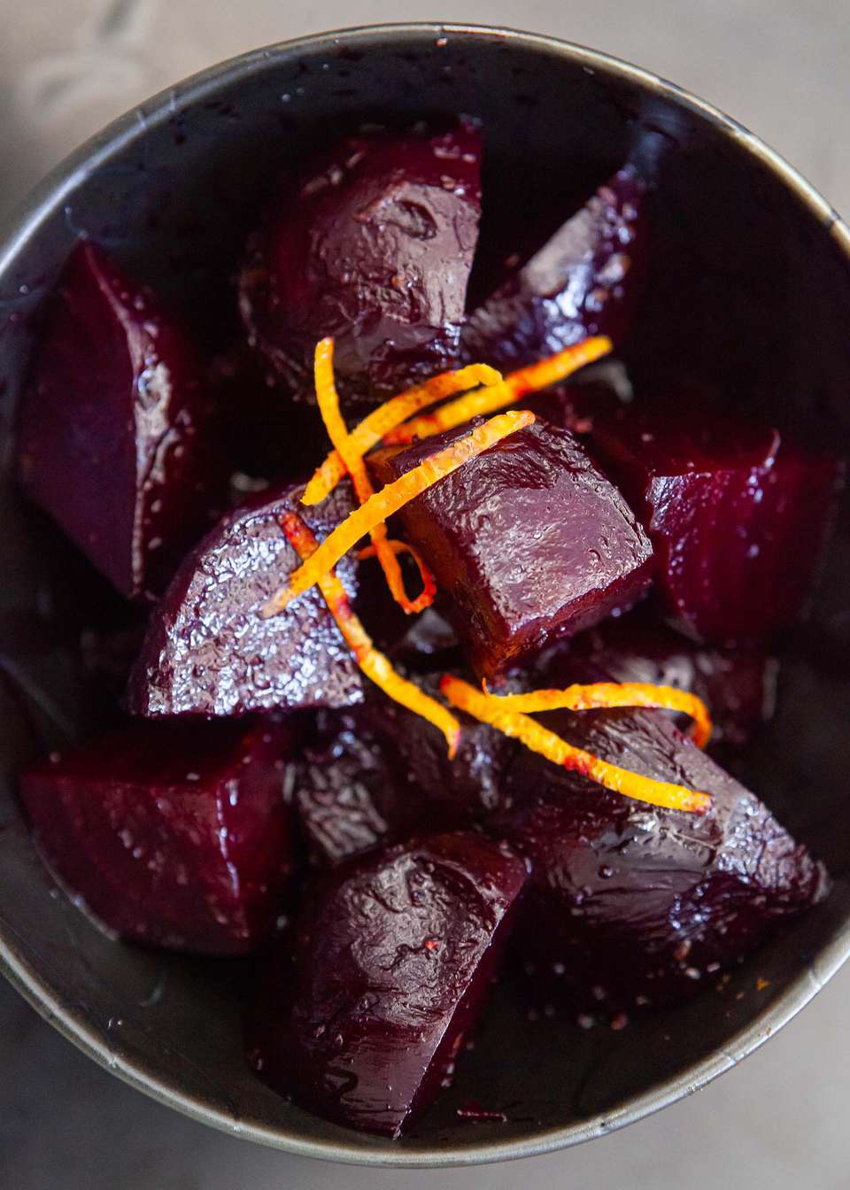 roasted beets with orange in a serving bowl
