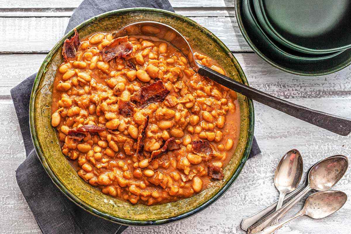 How to Make Baked Beans - baked beans in a dish with a spoon