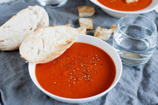 Best Tomato Soup Recipe - bowls of tomato soup on table with bread
