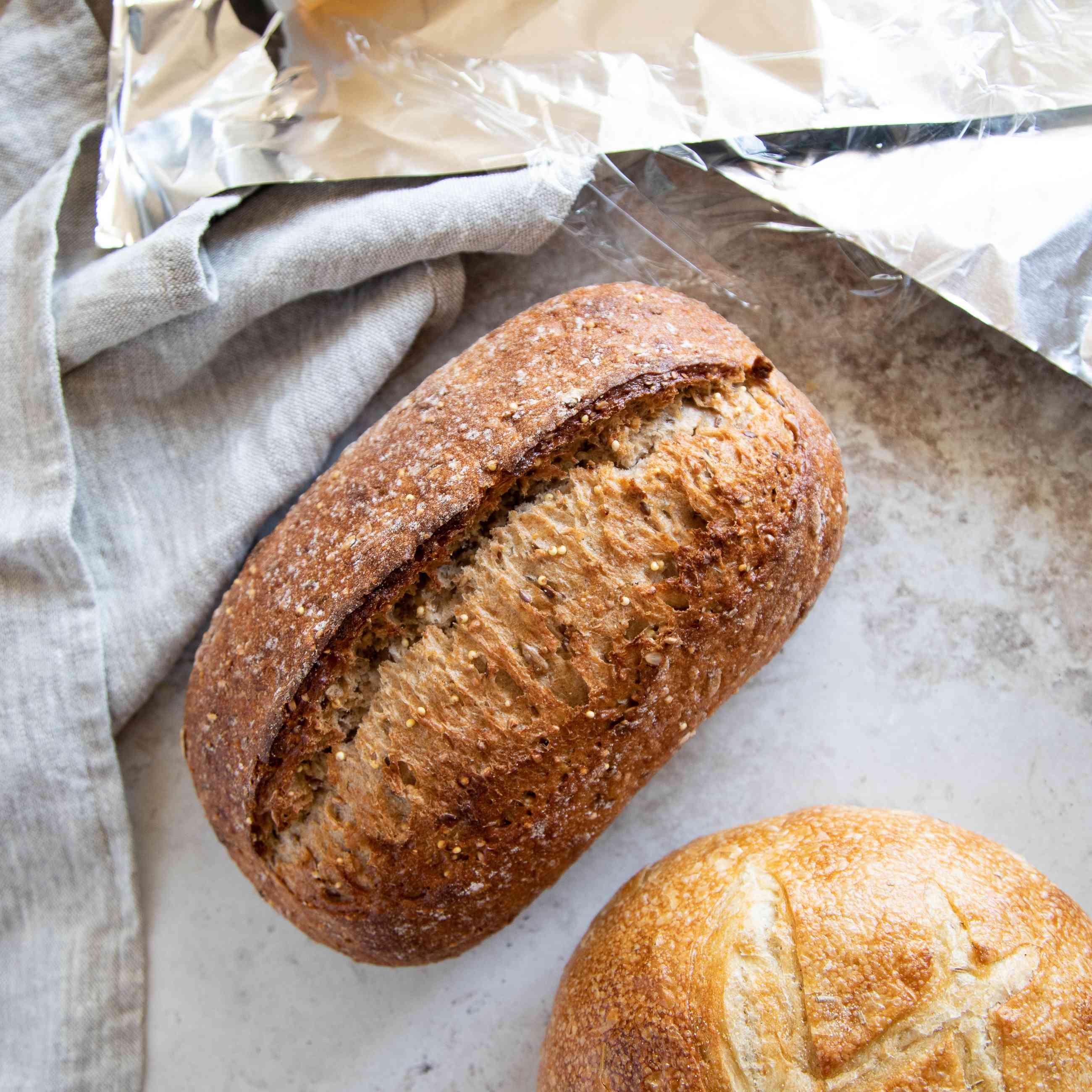Artisan bread loaves and saran wrap