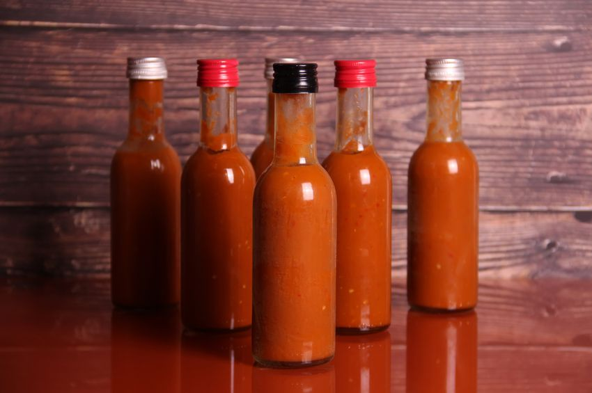 bottles of hot sauce on a table