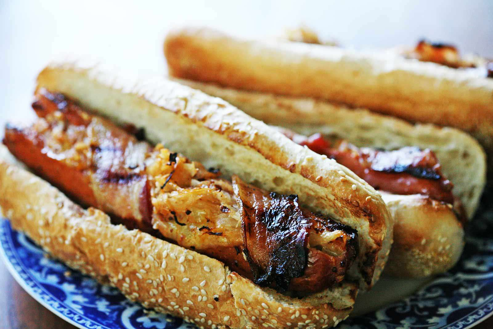 Bacon Wrapped Hot Dogs in buns ready to serve