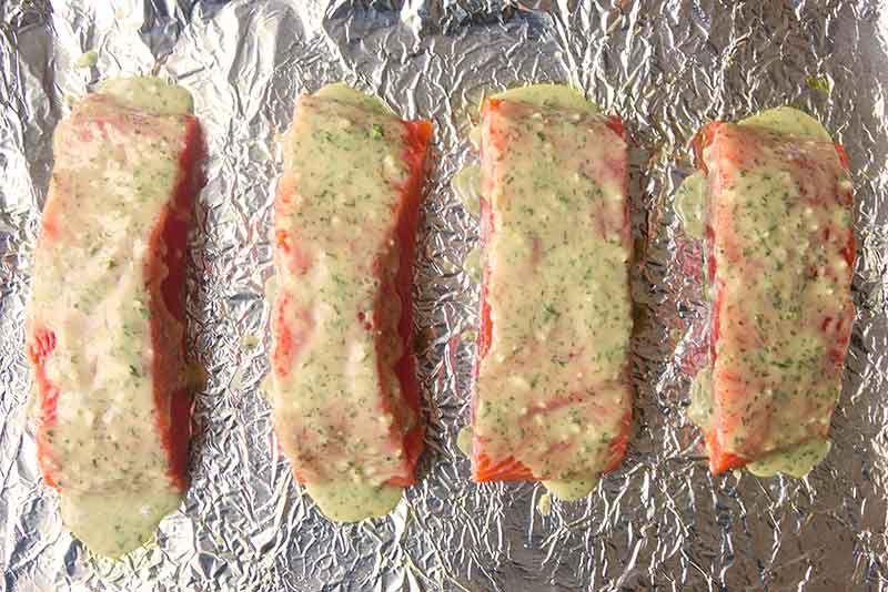 raw salmon with honey mustard on the sheet pan