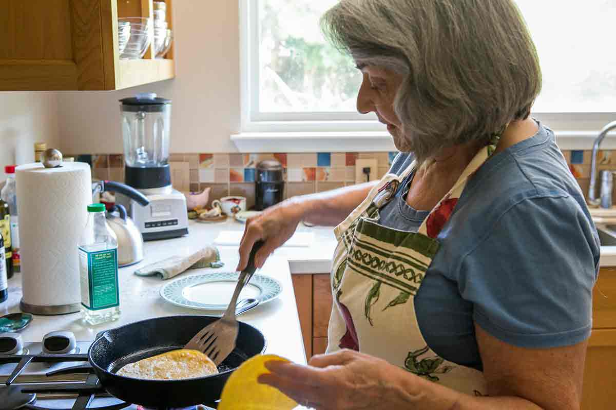 Elise's mother softening tortillas for enchiladas