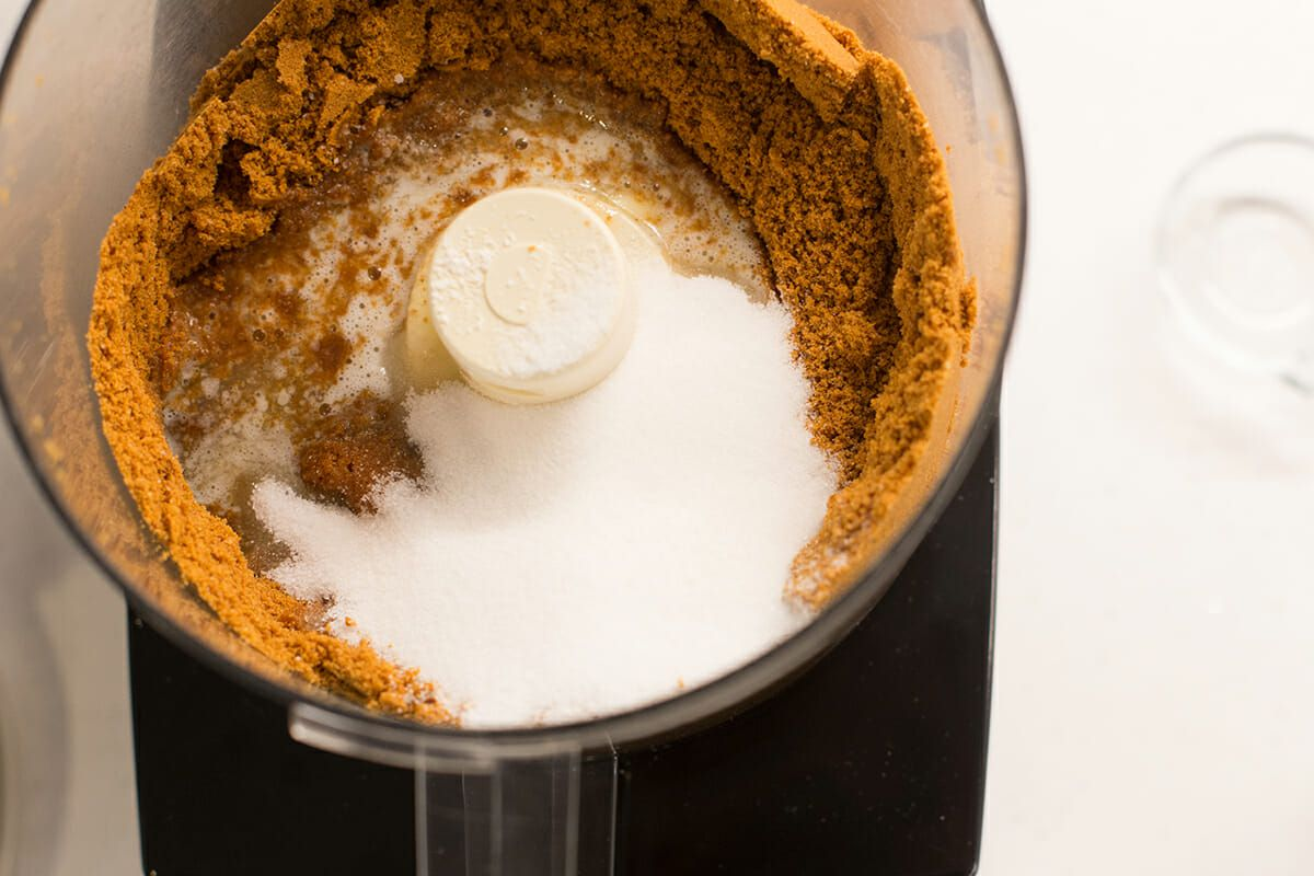 Best Cheesecake Recipe with Lemon - crushed ginger snaps in food processor with sugar