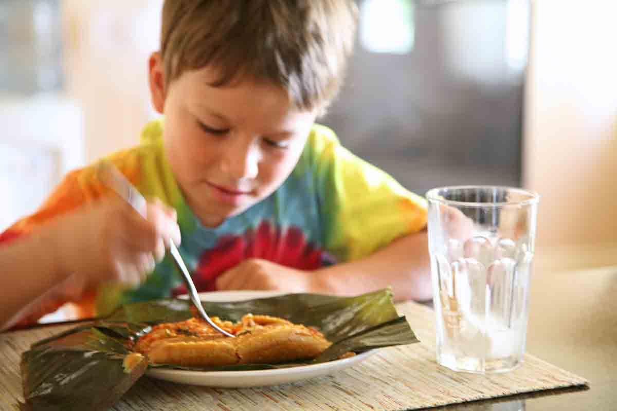 child eating vegetarian tamale