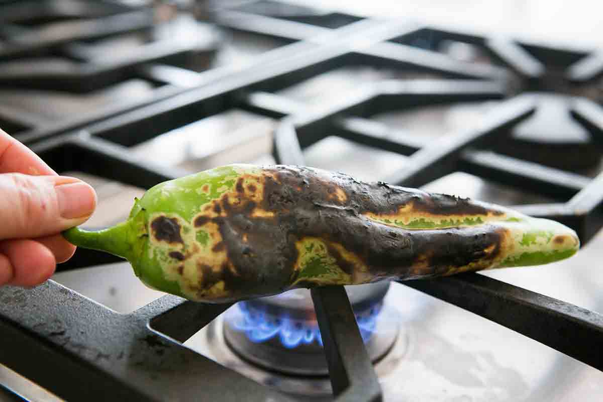 roasting green chile over open flame until charred