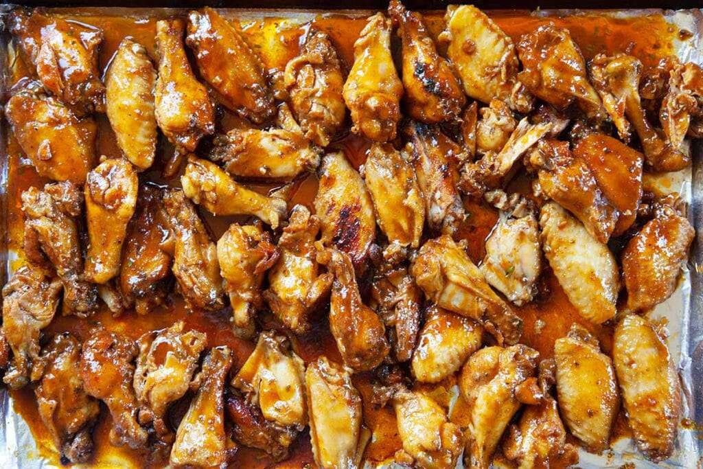 Chicken wings in a hot honey sauce on a platter