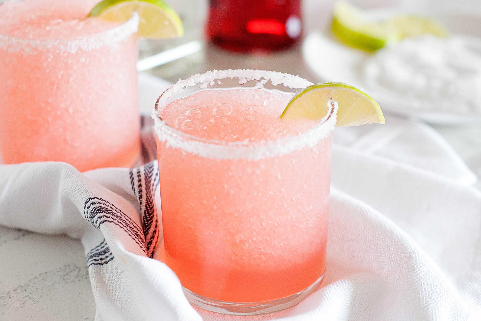 Tequila frozen siesta cocktails in short glasses with salt and lime