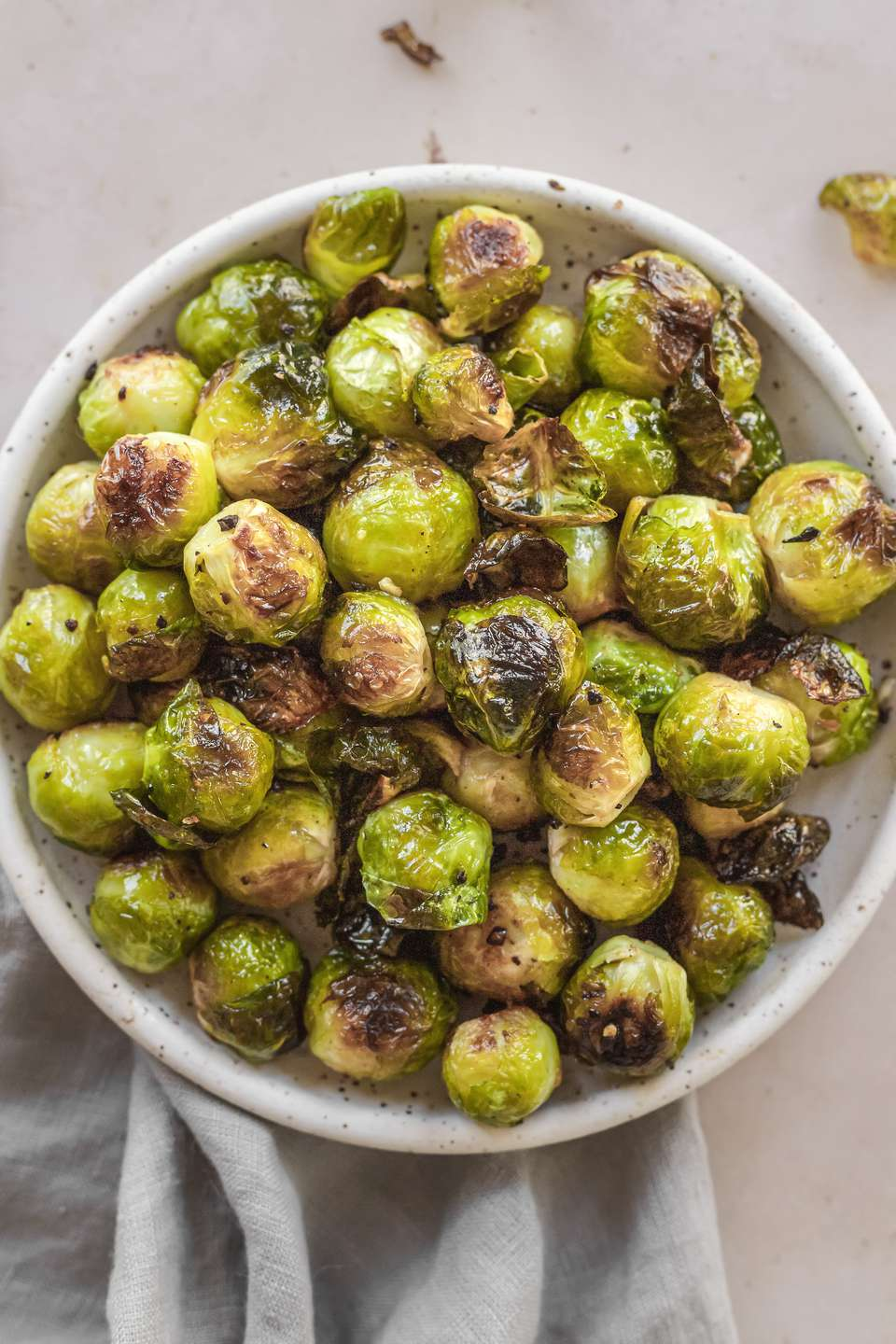 Overhead view of a serving dish of oven roasted brussel sprouts.