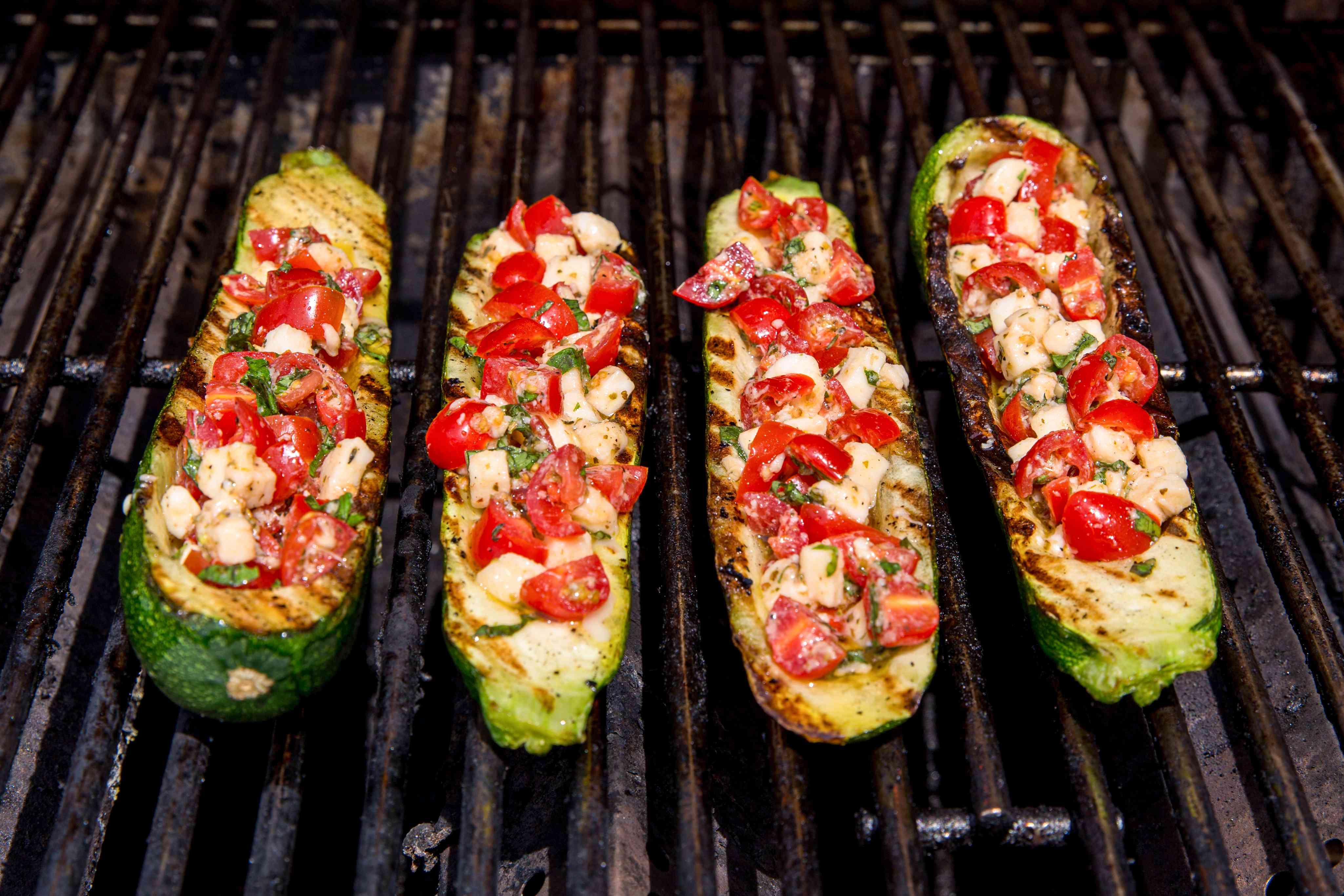 Stuffed zucchini boats on the grill.