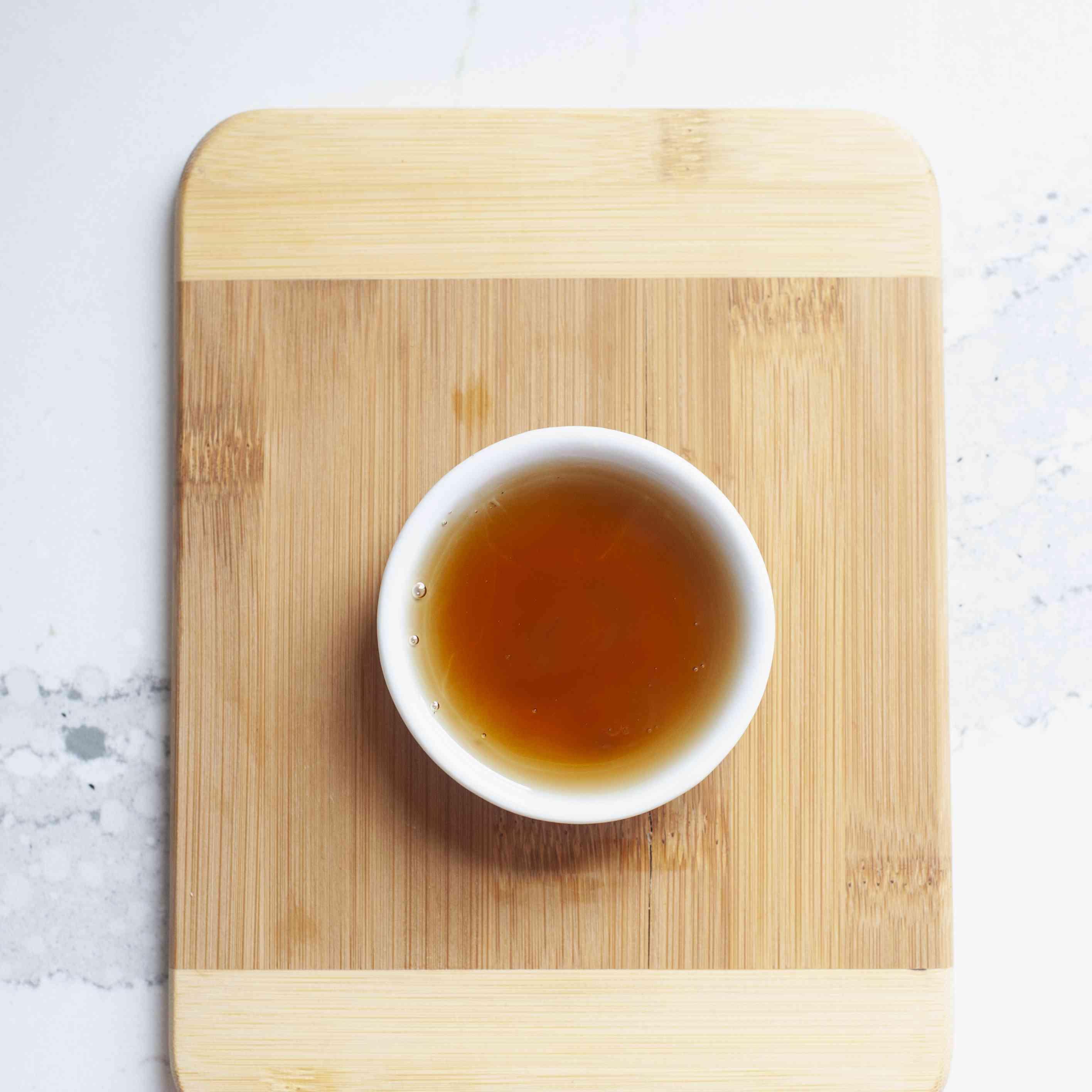 Toasted sesame oil in white bowl