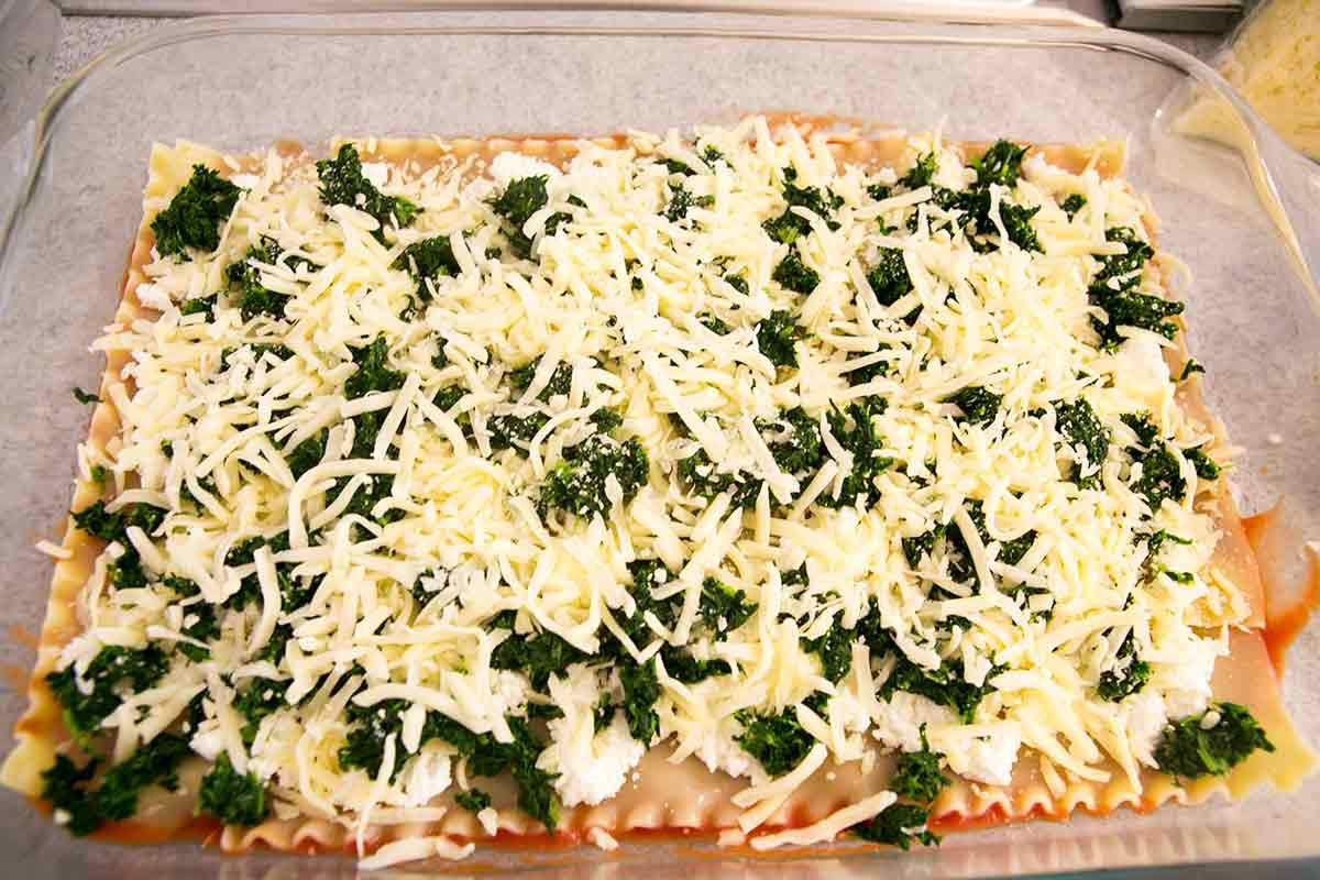 Vegetarian lasagna recipe adding the cheese and spinach