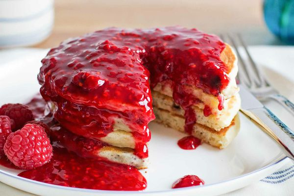Chocolate Chip Pancakes with Raspberry Sauce - close up of pancake stack