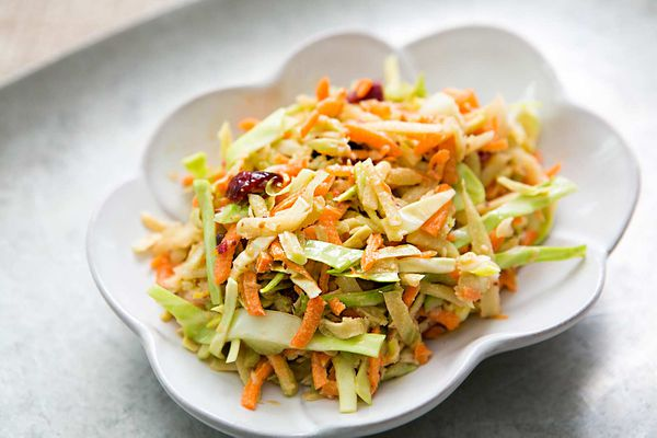 Broccoli Slaw with Cranberry Orange Dressing in a white bowl