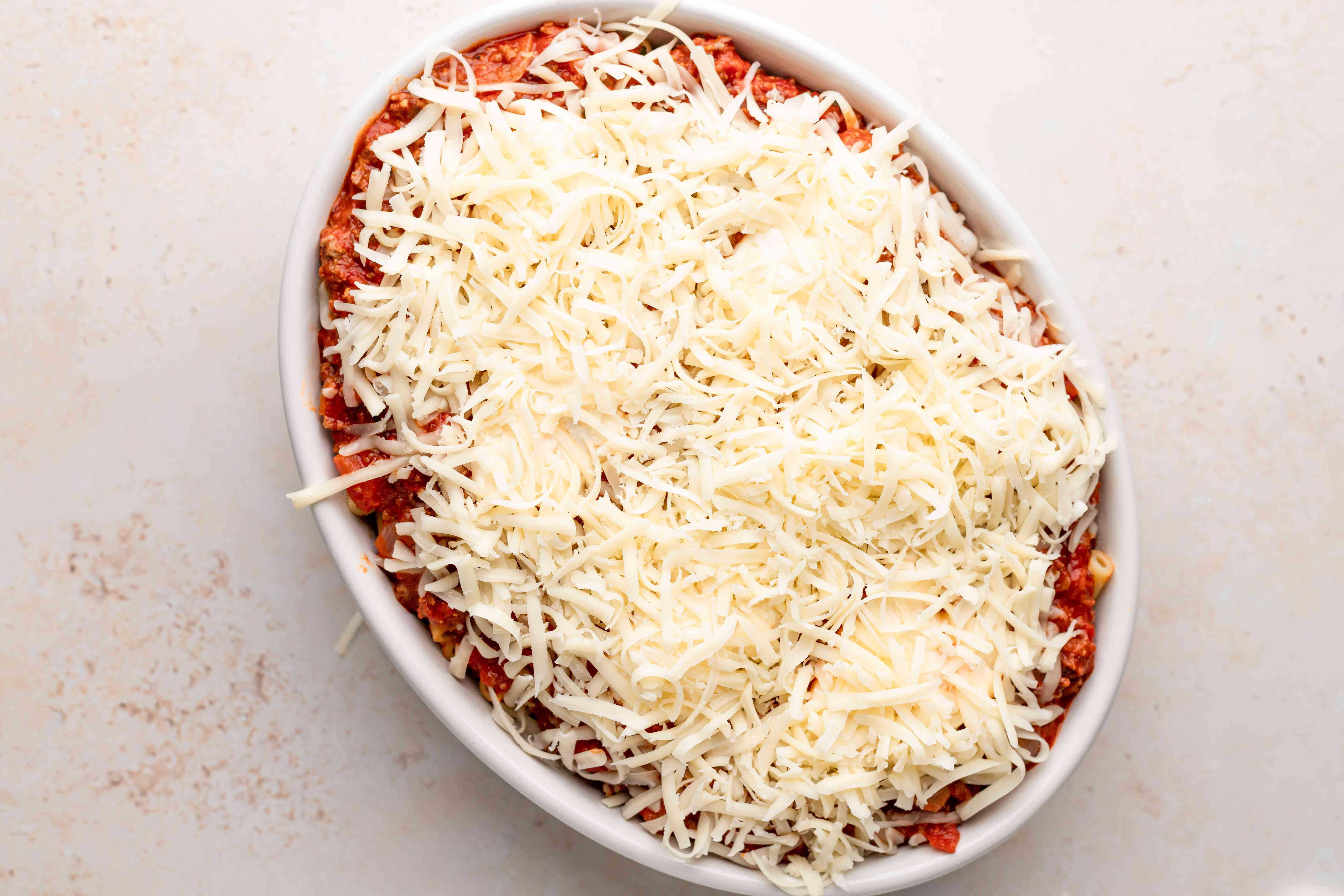 Shredded cheese topping a pasta bake.