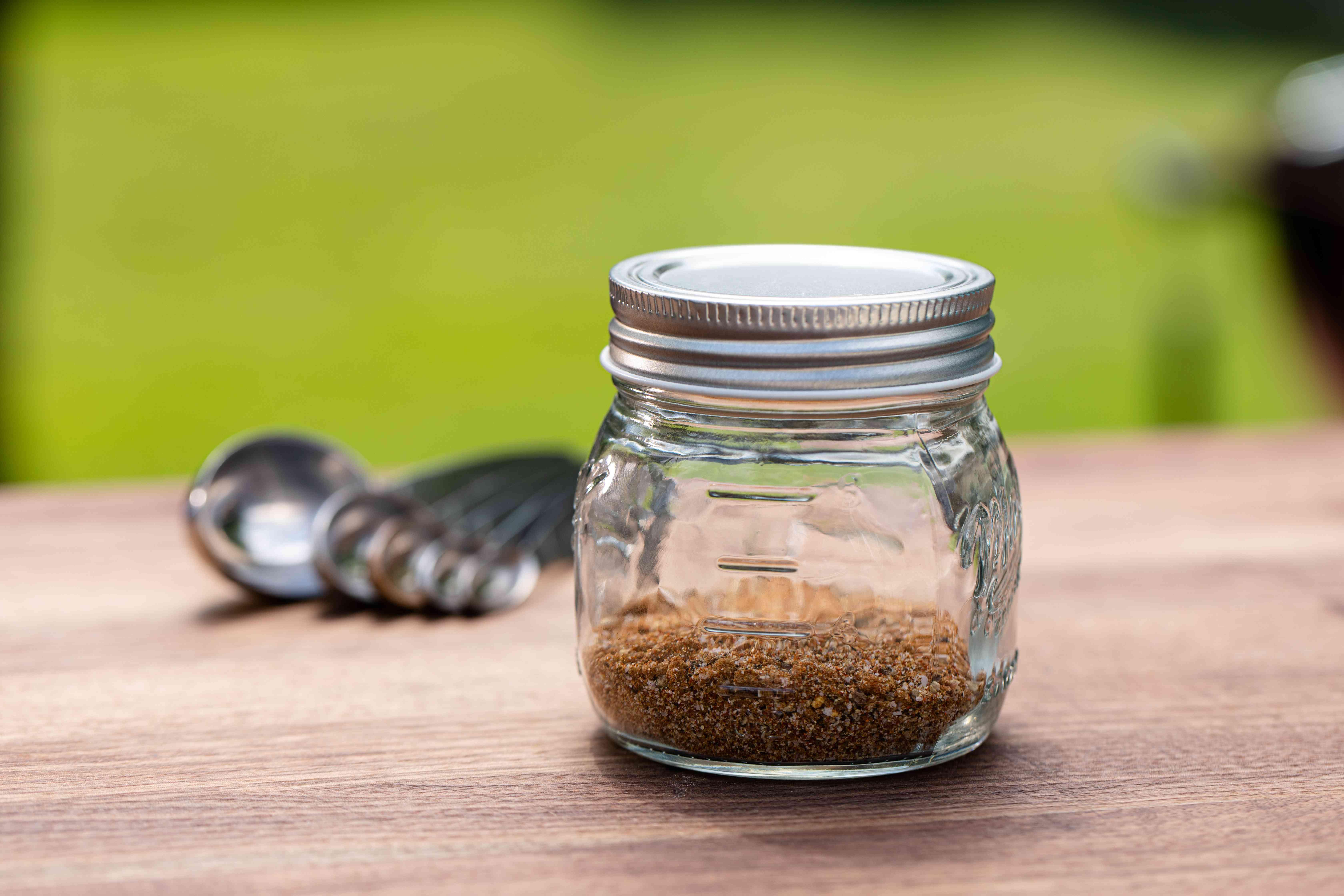 Hamburger Seasoning outside in a glass jar.