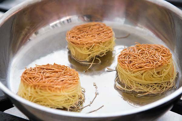 Browned angel hair nests for sopa seca de fideo