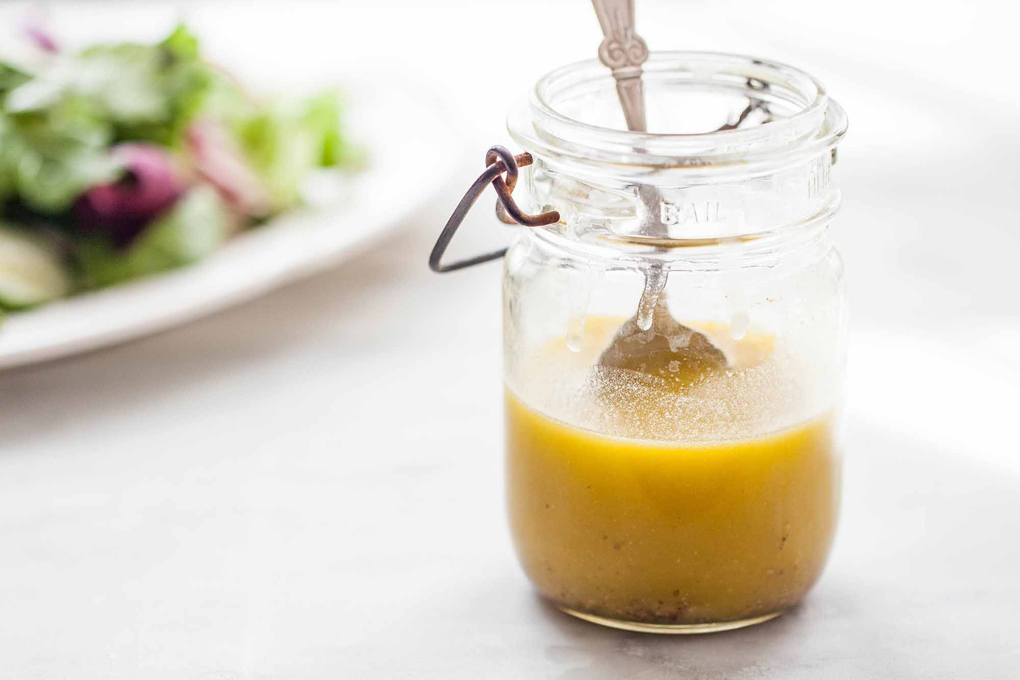 Homemade Honey Mustard Dressing - ball jar with honey mustard dressing wtih silver spoon