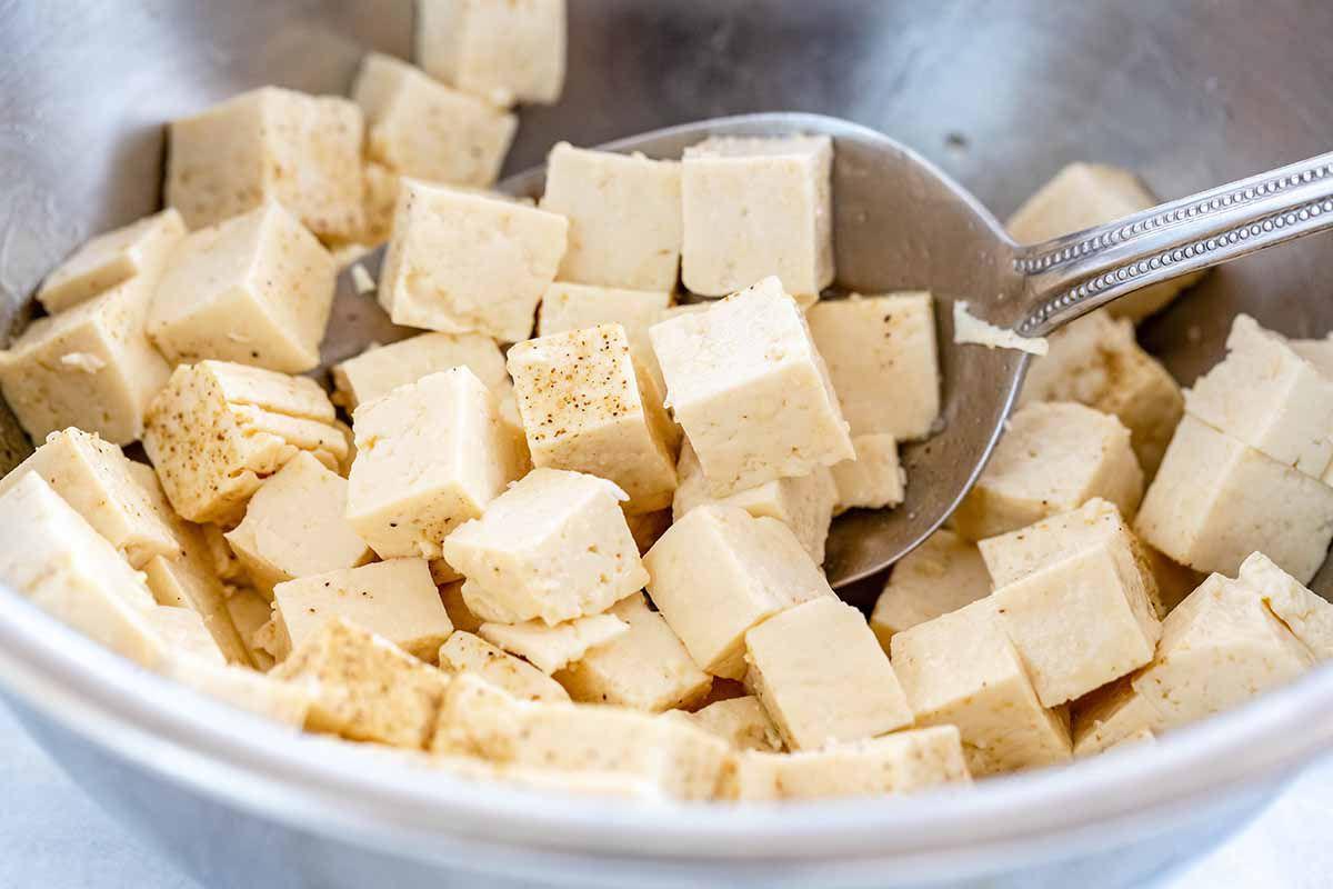 Vegan Cauliflower Fried Rice - tofu in bowl with spoon