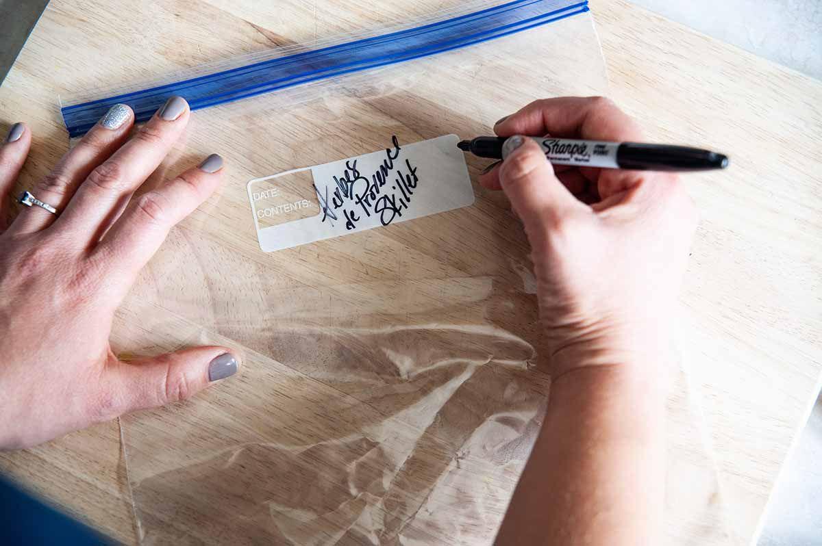 Skillet Chicken -- hands labeling a zip top bag
