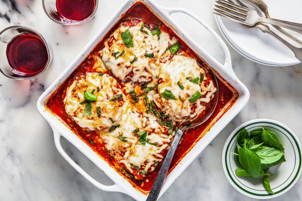 Overhead view of a baking dish of gluten free eggplant parmesan.