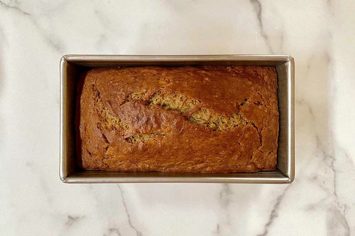 Loaf of the best gluten free banana bread on a marble background.