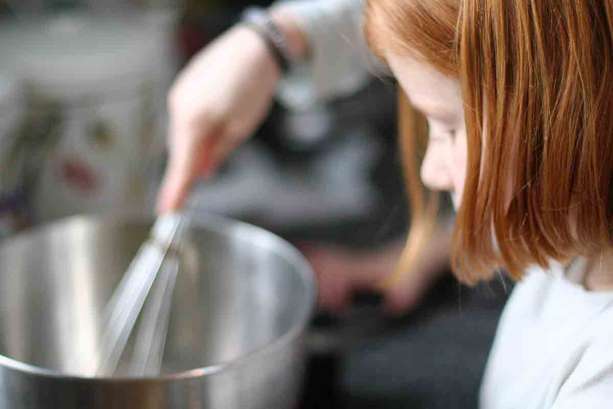 whisking egg mixture for crunchy french toast