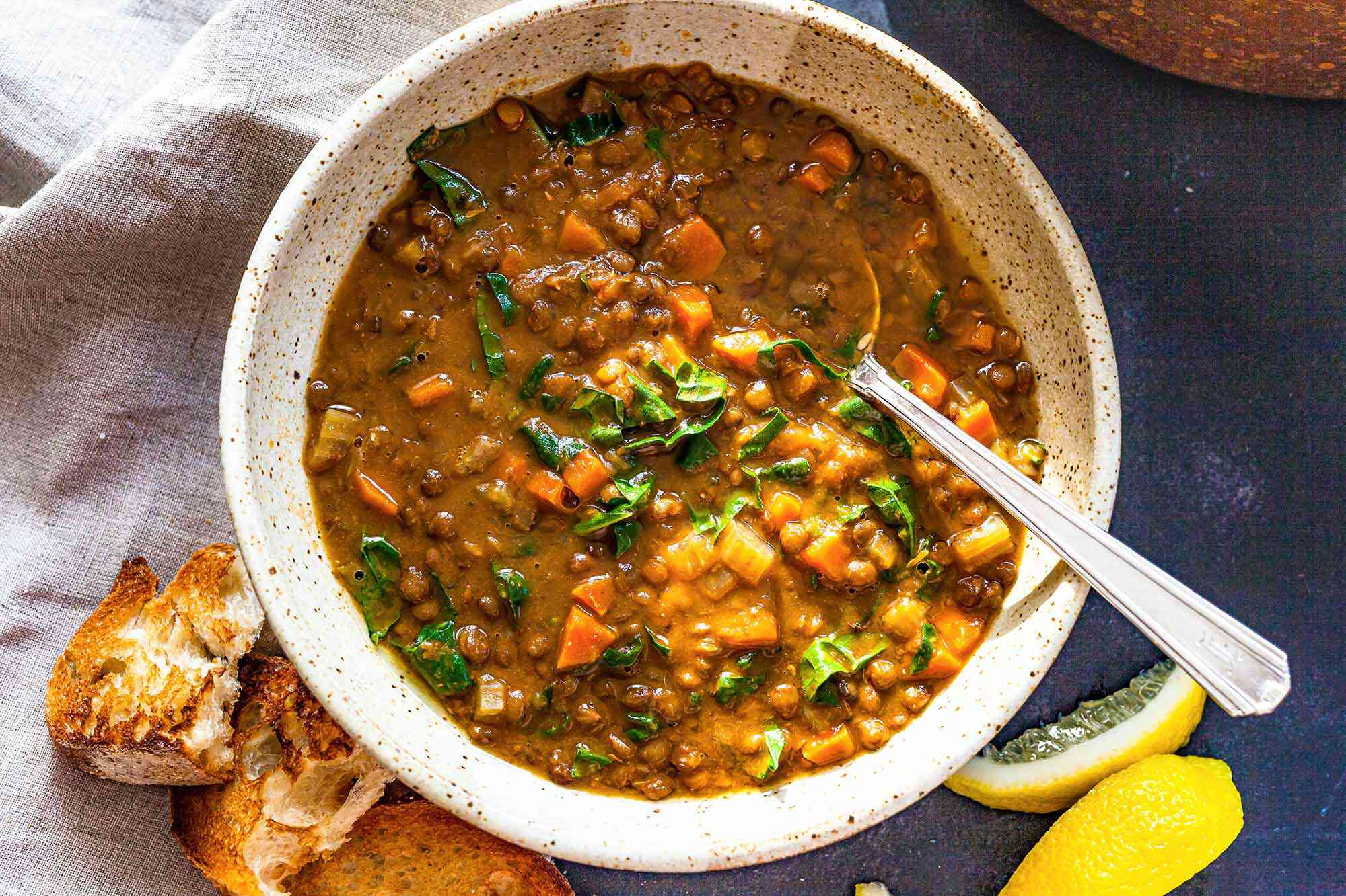 Easy Lentil Soup in a bowl with a spoon.