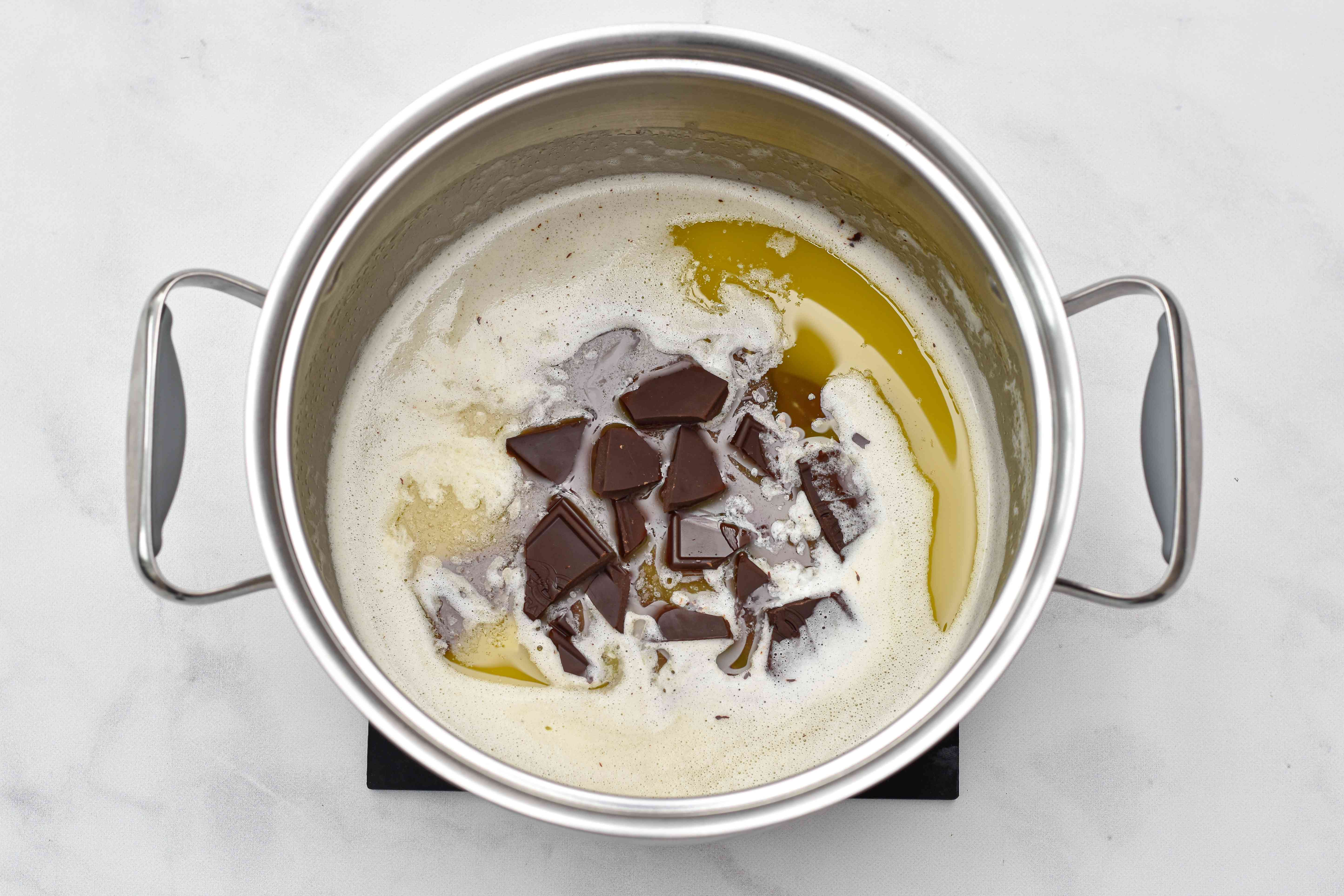 Butter and chocolate melting together to make Salted Caramel Brownies