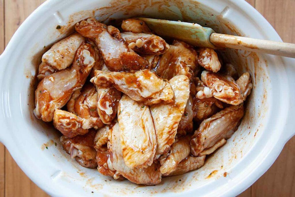 Combine the honey hot sauce and chicken wings for honey buffalo chicken wings recipe in the slow cooker