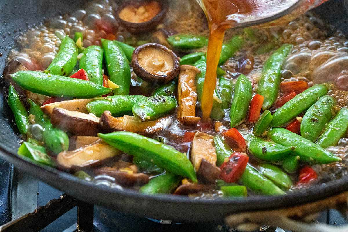 Stir fried vegetables with sauce poured on top to make a One Pot Vegetarian Stir Fry.