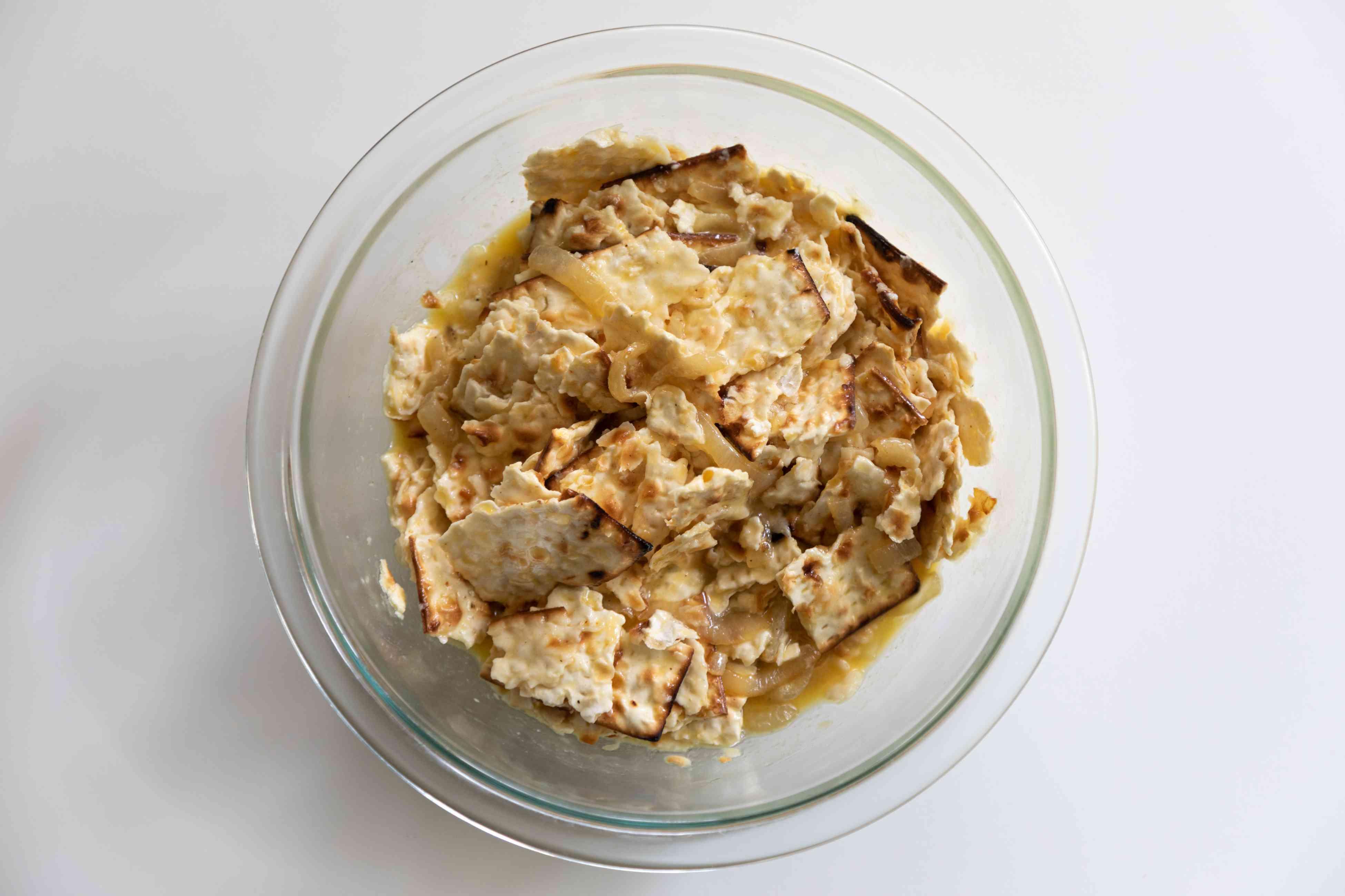 Broken matzo crackers in a bowl.