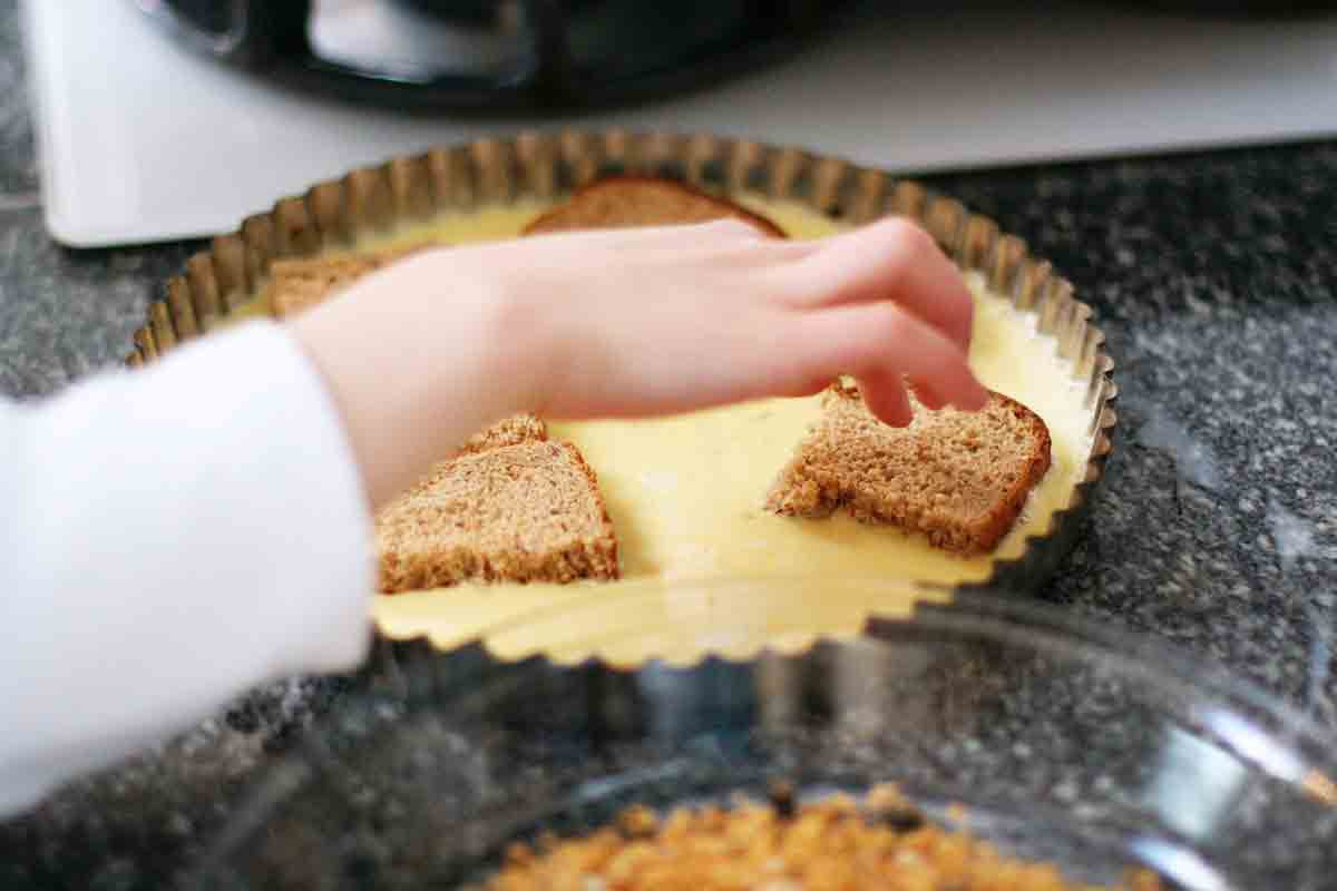 dipping toast squares into egg batter
