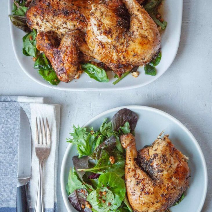 Feta-brined roast chicken on a platter and plate