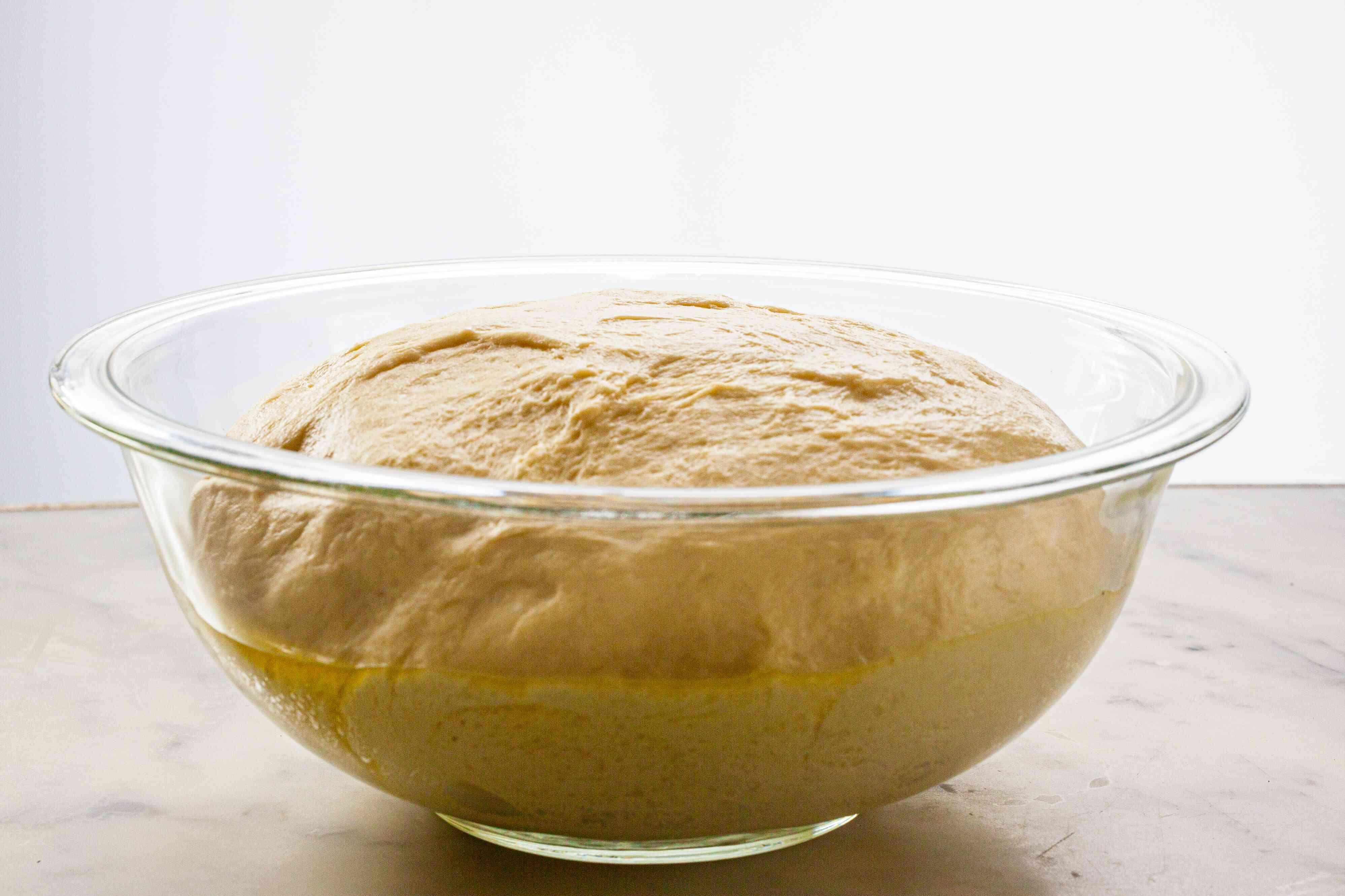 Risen dough to make homemade hamburger buns.