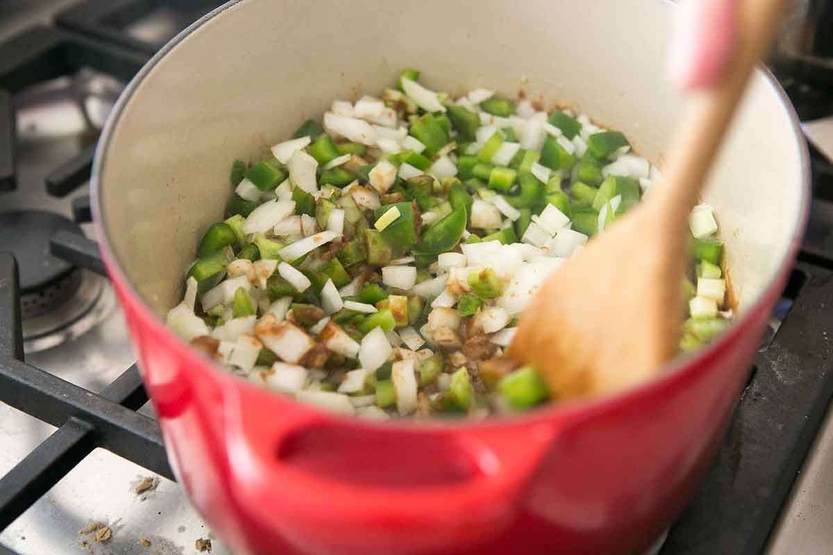 Stir the peppers, onions, and celery for shrimp gumbo into the roux