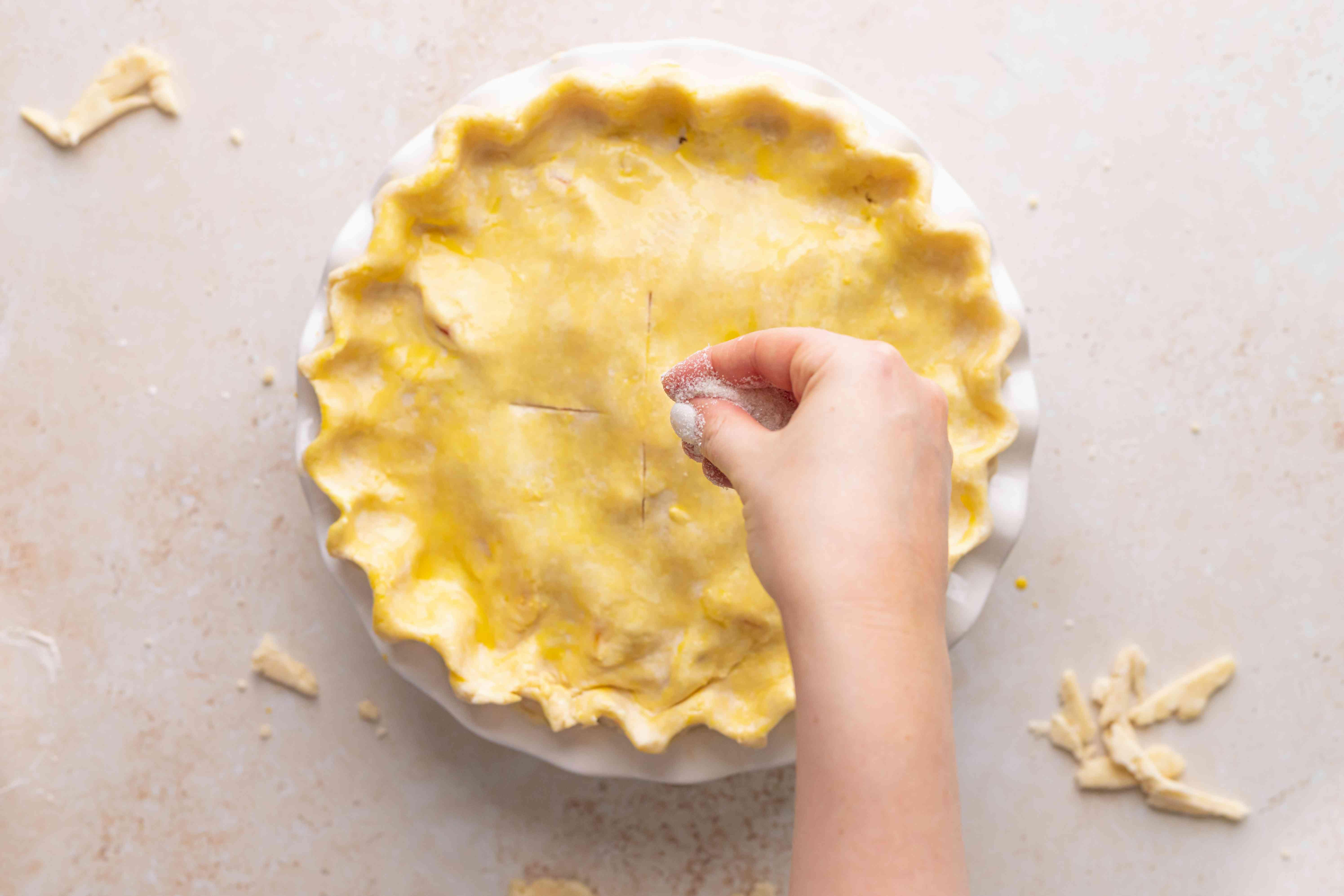 Sprinkling pie with Turbinado sugar before baking.