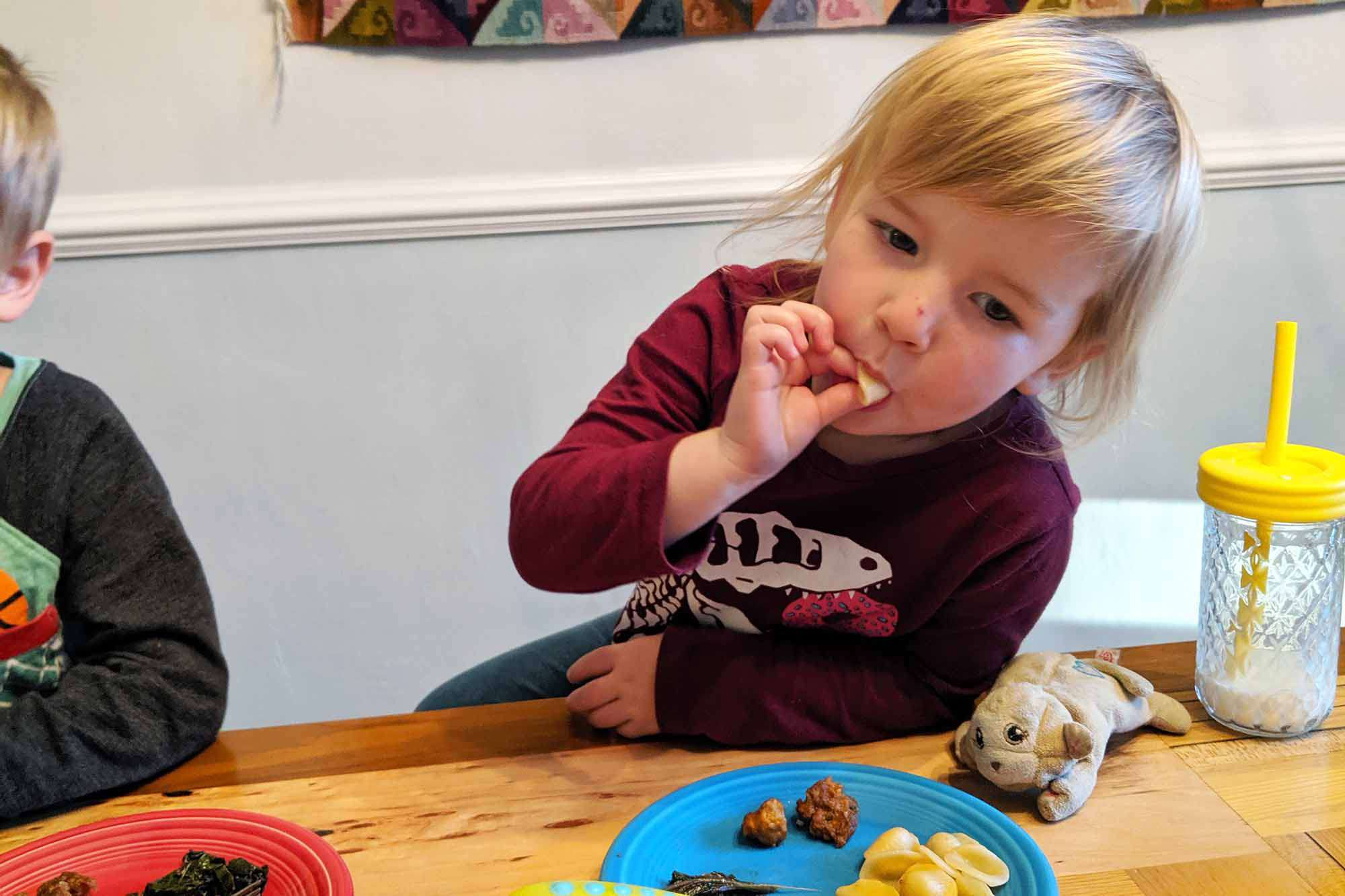 Kids try pasta with kale and sausage
