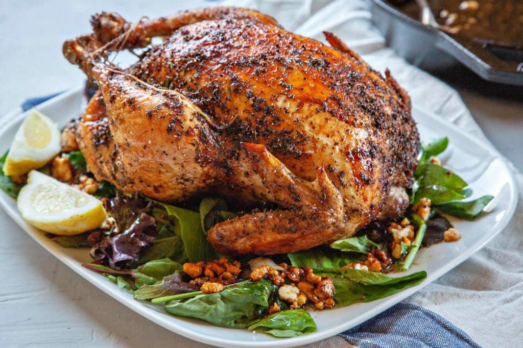 Feta-brined roast chicken on a bed of greens