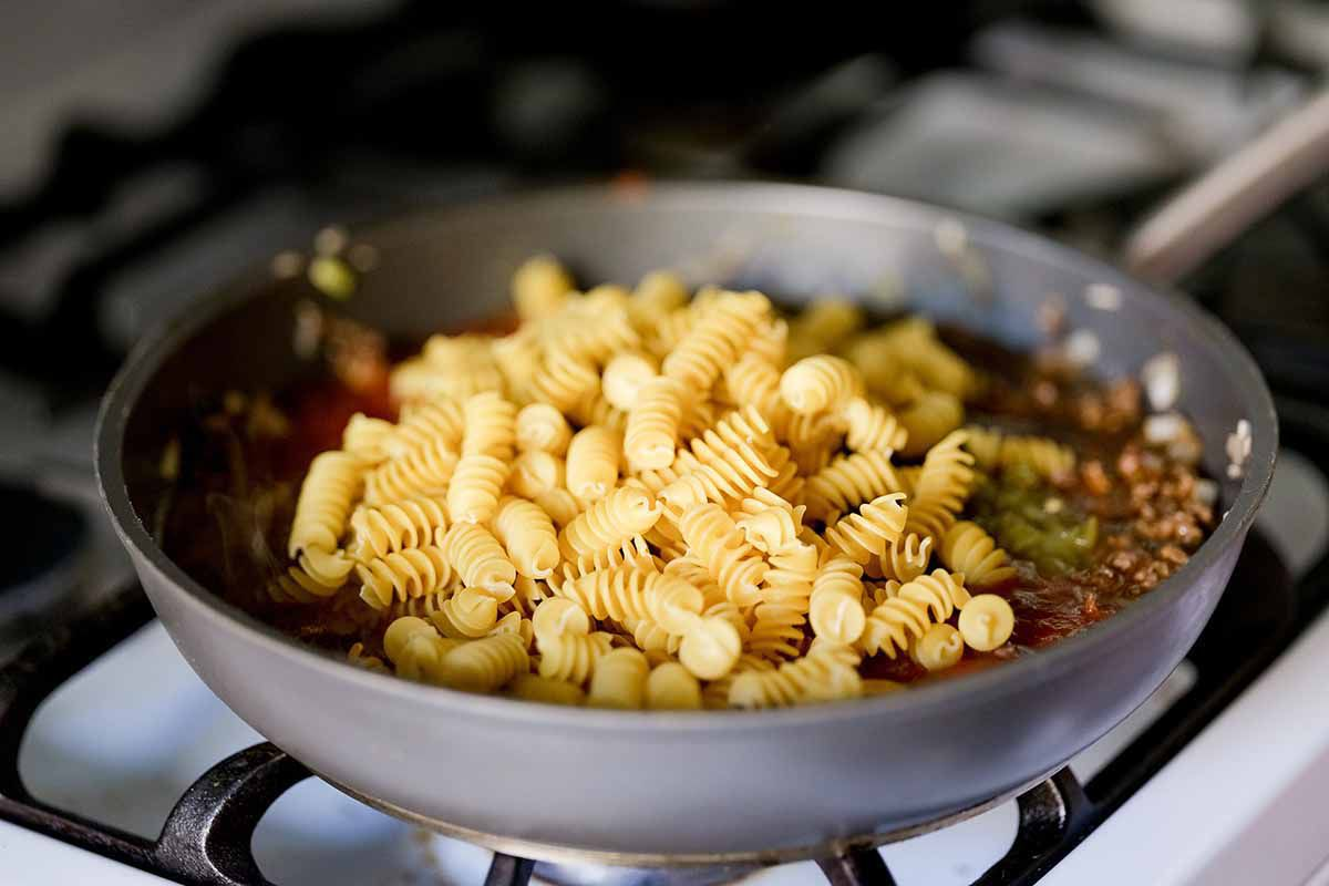 Taco Pasta Skillet Recipe add pasta and simmer