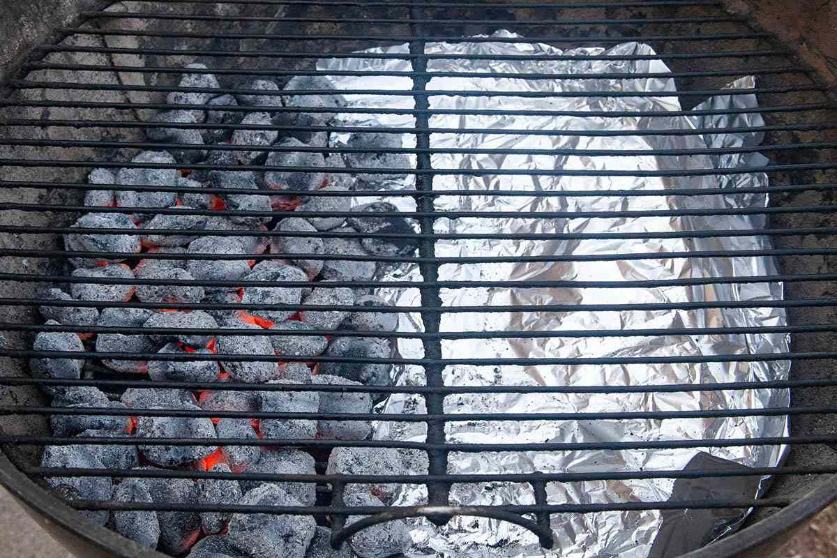 A grill with the coals set up to make a Korean Baby Back Rib Recipe.
