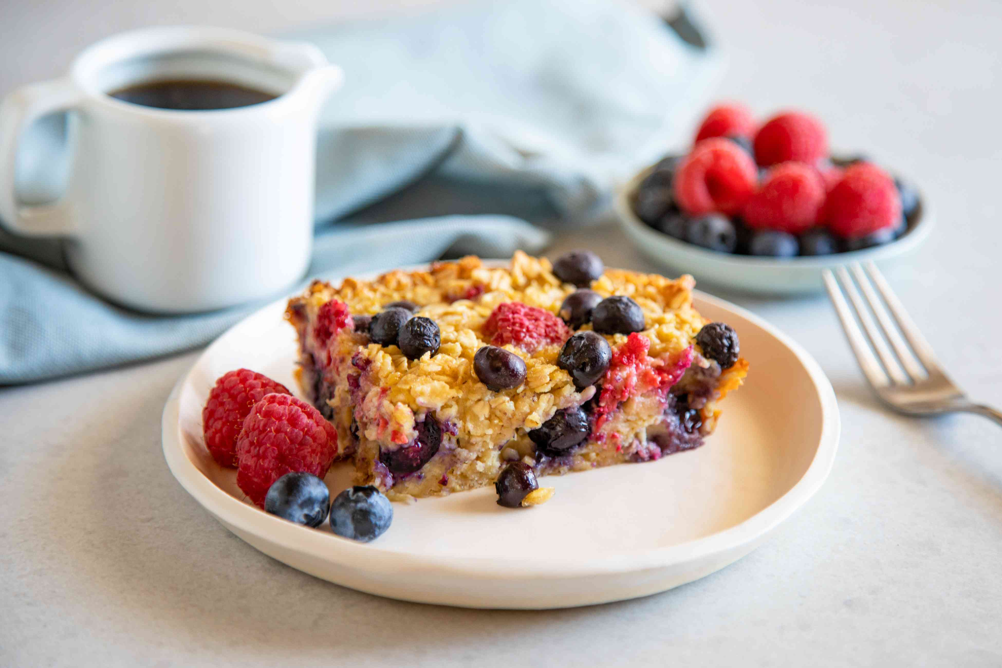 Gluten-Free Baked Oatmeal served on a plate and sprinkled with berries.