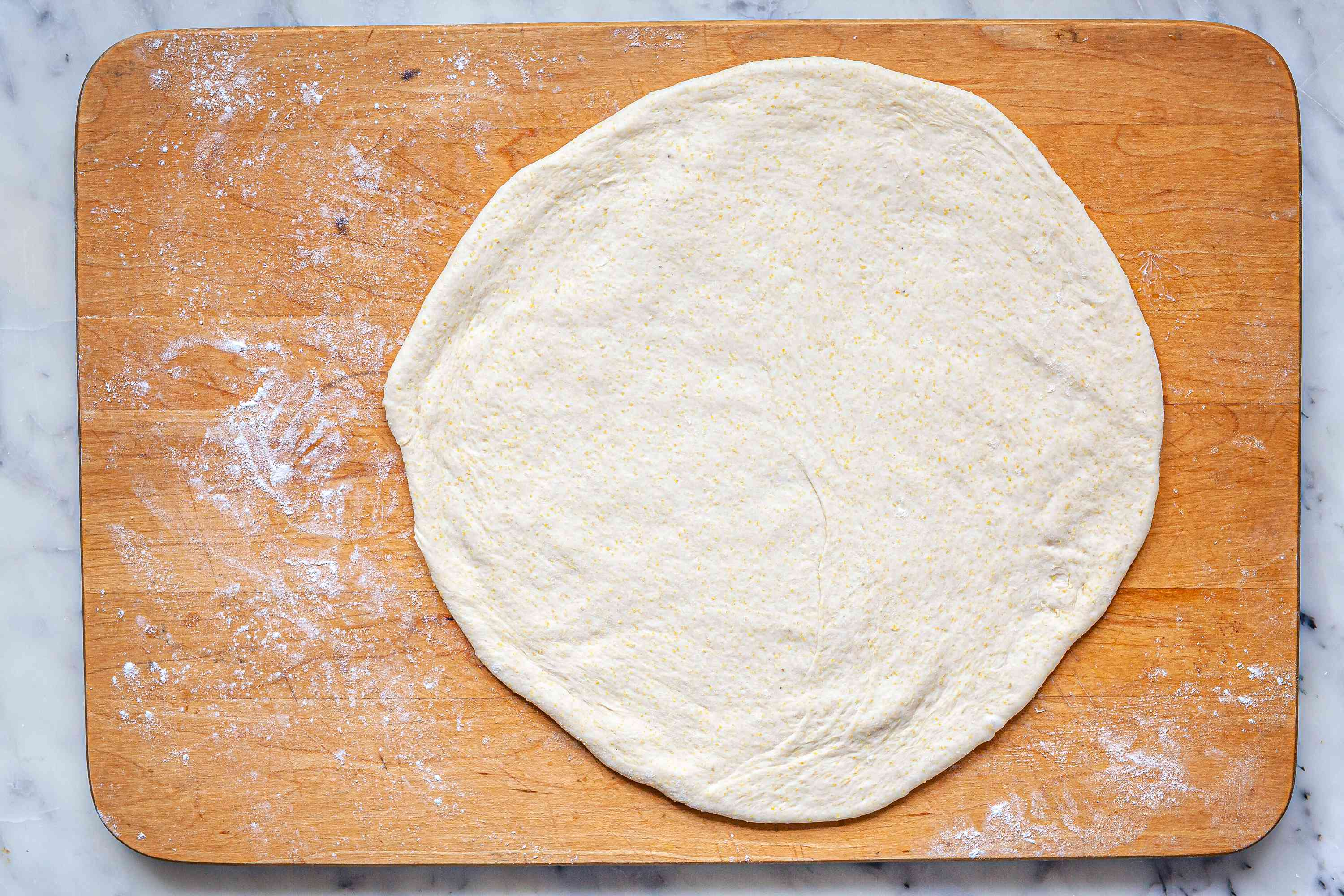 Dough rolled into a circle for Chicago-Style Deep Dish Pizza.