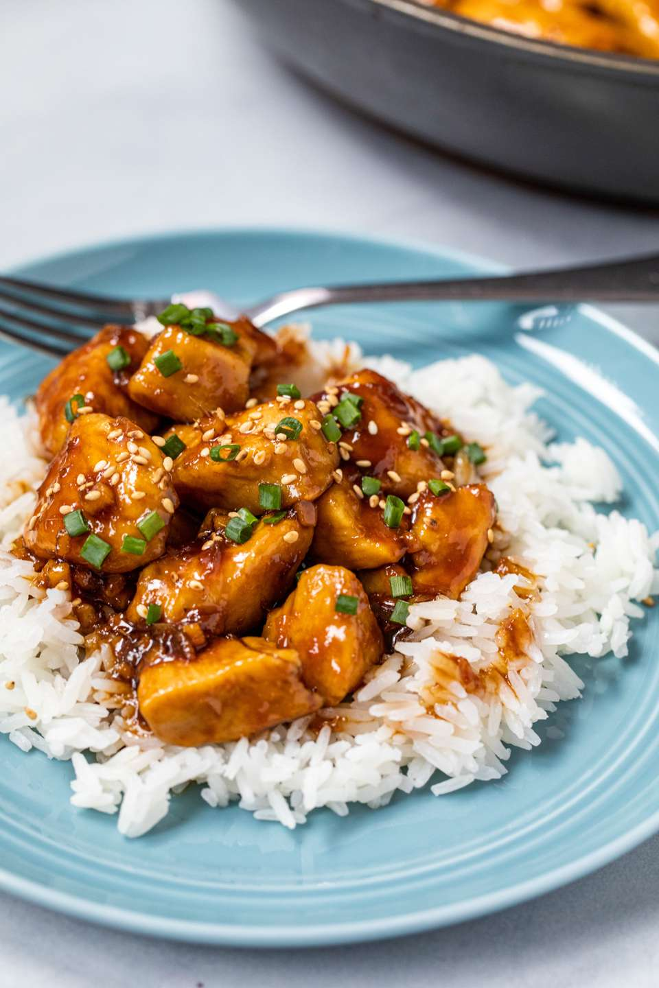 Easy Bourbon Chicken served over rice.